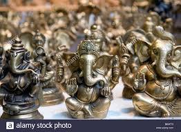 brass ganesh ornaments for sale in new delhi india stock photo