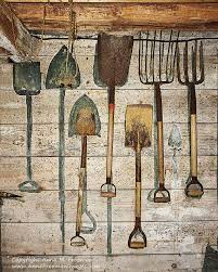 antique wood wall a rustic charmer a barn workroom with tools hanging on
