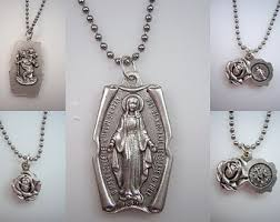 catholic pendants 2 catholic pendants with stainless steel the redeemer
