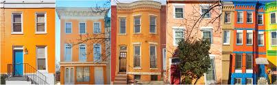 row homes rainbow baltimore colorful rowhomes uncustomary