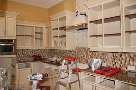 crowded spray painting kitchen cabinets with cream wall framed