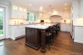 white kitchen cabinets with brown floors ben white dove painted cabinets with walnut stained