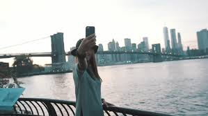 New York traveling images Travel girl is traveling in new york pick up taxi making selfie resiz