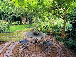 gap gardens sitting area under tree in garden image no