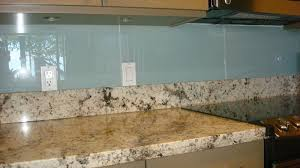 kitchen glass backsplash with colonial cream granite countertop
