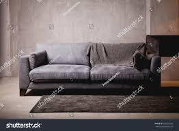 gray velour sofa dark room bright stock photo 559253542 shutterstock
