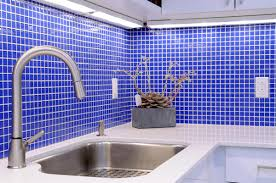 seamless kitchen with glass wall storage and glass mosaic tile