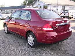 red nissan car earthy cars blog earthy car of the week red 2009 nissan versa
