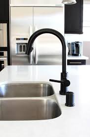white kitchen faucets black is the new black design milk
