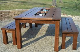 How To Make A Picnic Table Bench Cover by Remodelaholic Build A Patio Table With Built In Ice Boxes