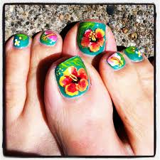pretty tropical pedicure turquoise polish with red hibiscus