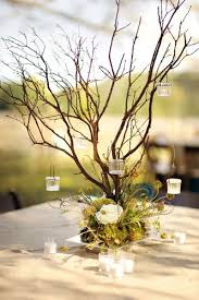 rustic wedding centerpieces branches and hanging votives rustic wedding centerpiece tulle