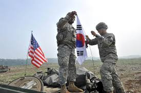 Soldier With Flag U S Military Says South Korea Databases Hacked Personal Data