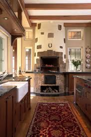 kitchen style stone brick fireplace persian rug white tile in