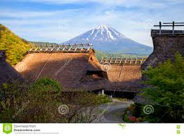 old traditional japanese houses with mount fuji editorial stock