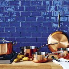 blue kitchen tiles a great match blue kitchen tiles and copper saucepans http www