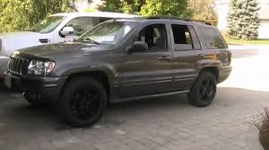 black jeep liberty with black rims murdering out the jeep wheels painted and mounted and whats next