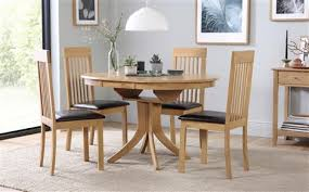 round extending dining room table and chairs hudson round extending dining table 4 chairs set bewley oatmeal
