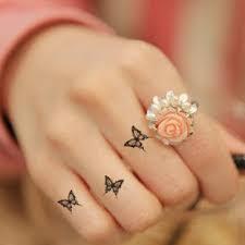 butterfly finger tattoos piercings finger