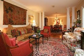 traditional living room with hardwood floors crown molding