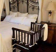 baby crib attached to bed the deep walnut babybay bedside sleeper is a co sleeper baby crib