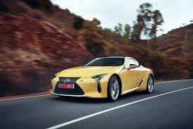 white lexus 2018 lexus lc front three quarter in motion 500h first drive review