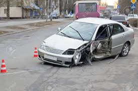 a crashed car as a result of a street road accident stock photo