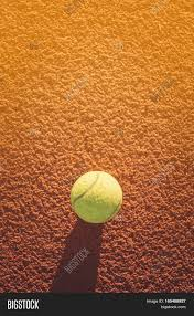 vintage yellow color close up of tennis ball on clay court tennis ball vintage tone
