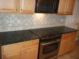 stunning black granite countertops with tile backsplash with home