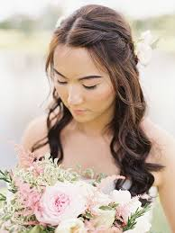bridal wedding hairstyle for long hair half up wedding hairstyle ideas with curls flowers and braids