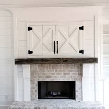 mantle barn doors over tv interior barn doors pinterest