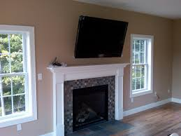 stonington ct u2013 tv over fireplace on articulating mount tv
