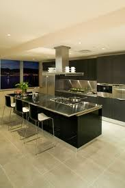 modern kitchen with black island and dark brown european style