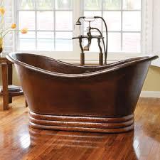 bathrooms bathroom decor with bright copper bathtub on wooden
