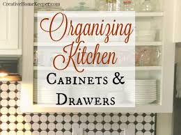 how to organize kitchen cupboards and drawers organizing kitchen cabinets drawers creative home keeper
