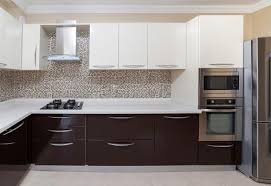 White Kitchen Cabinets That Give An Illusion Of Spaciousness Brown