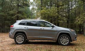 raised jeep cherokee 2017 jeep cherokee in depth model review car and driver