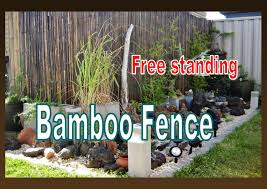 free standing bamboo fence installation in the garden liz
