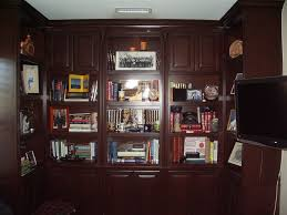 floor to ceiling built in bookshelves are the perfect home office