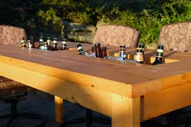 a diy table with built in drink coolers is the perfect way to beat