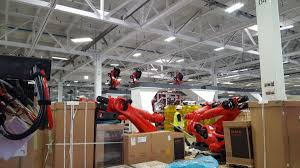 tesla factory leaked photos from tesla show the u201calien robots u201d that will build