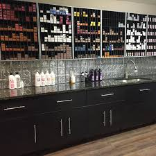 each stylist would have their own developer bottles under cabinet under cabinet lighting