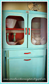 love the red handles on this old painted kitchen cabinet red