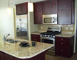 small cherry finished galley kitchen with marble top kitchen