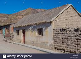 old style home construction adobe and thatched roof in tahua