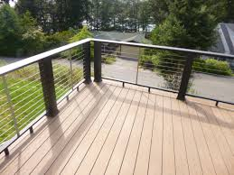 composite lumber deck with cable railing and front porch