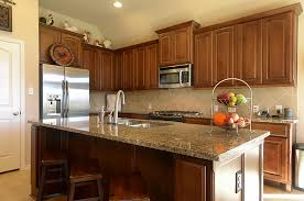 kitchen cabinets and backsplash countertop and backsplash that goes with medium wood cabinets