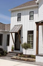 painted brick exterior traditional with oval window window trim