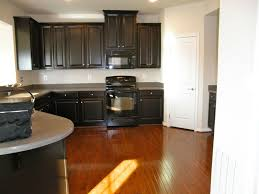Medium Brown Kitchen Cabinets by White Kitchen Cabinets Dark Wood Floors Picture Awesome Innovative