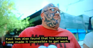 paul has found it hard to get work with giant tattoos all across